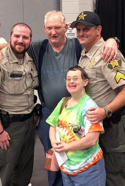 Police officers interacting with people with special needs